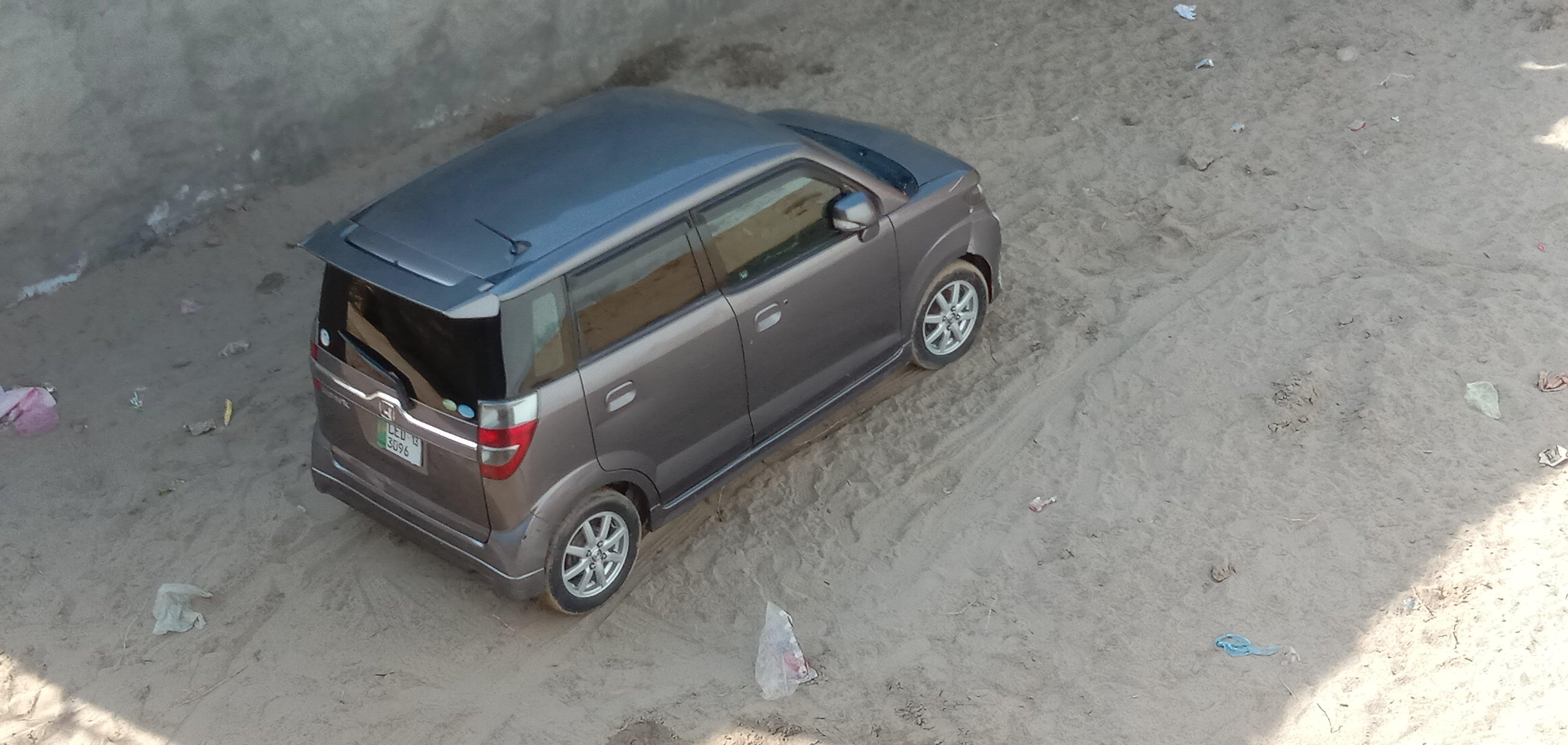 car for rent in awan market lahore